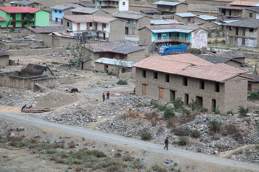 People walk in the village of Sunchubamba, a Quechua speaking native community in Southeastern Peru that is running a reforestation plot in the Andes near Cusco and the Interoceanic Highway.
