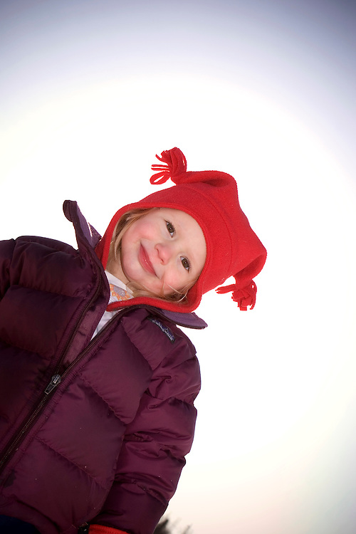 USA, Alaska, Claire Carroll is all geared up for some outdoor winter fun in Anchorage, Alaska. MR