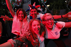 © Licensed to London News Pictures. 03/07/2021. London, UK. Football fans react to the EURO 2020 Quarter-final between Ukraine and England from Rome, Italy as they watch the match on a giant screen at Boxpark Croydon, south London. Photo credit: Peter Macdiarmid/LNP