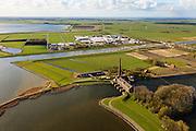 Nederland, Friesland, Gemeente Lemsterland, 16-04-2012; Lemmer, ir. D.F. Woudagemaal. Prinses Marijkesluis en industrieterrein. Het stoomgemaal staat op de Unesco Werelderfgoedlijst en is het grootste nog in bedrijf zijnde stoomgemaal ter wereld. Bij extreem hoge waterstand doet het gemaal nog dienst en helpt om de waterstand van het Friese boezem op peil te houden. Sinds 1967 is het gemaal oliegestookt. ..Lemmer, ir D.F. Woudagemaal. The steam pumping station features on the UNESCO World Heritage List and is the largest pumping station still in operation worldwide. At extreme high water, the station is still in service and helps to maintain the proper water level of the Friesian boezemwater. Since 1967, the pumping station is oil fired...luchtfoto (toeslag), aerial photo (additional fee required).foto/photo Siebe Swart