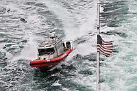 US Coast Guard Escort for the Alaska Marine Highway M/V Columbia leaving Bellingham Washington for Alaska. Image taken with a Nikon D300 and 18-200 VR lens (ISO 200, 200 mm, f/7, 1/160 sec).