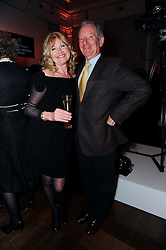 MICHAEL BUERK and DEBBIE MOORE at the presentation of the Veuve Clicquot Business Woman Award 2010 held at the Institute of Contemporary Arts, 12 Carlton House Terrace, London on 23rd March 2010.  The winner was Laura Tenison - Founder and Managing Director of JoJo Maman Bebe.