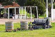 A collection of old and rusty wine presses in the yard at the winery. Vinedos y Bodega Filgueira Winery, Cuchilla Verde, Canelones, Montevideo, Uruguay, South America