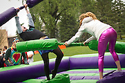 Elliot Karl '12, left, gets struck during a foam jousting tournament at Grinnell Relays on Mac Field. BEN BREWER/Grinnell College