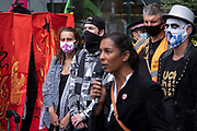 Speakers on the Walk of Shame disruptive mach through the City of London by environmental group Extinction Rebellion on 4th September 2020 in London, United Kingdom. The walk visited various locations in the financial district, to protest against companies and institutions with historical links to the slave trade, or who finance or insure projects which are seen as ecologically unsound. The message by the group is that 'apologies and token attempts at diversity are not enough to address this legacy and present reality. Our demand is reparations and reparatory justice for those affected by colonial and neo-colonial exploitation'. Extinction Rebellion is a climate change group started in 2018 and has gained a huge following of people committed to peaceful protests. These protests are highlighting that the government is not doing enough to avoid catastrophic climate change and to demand the government take radical action to save the planet.