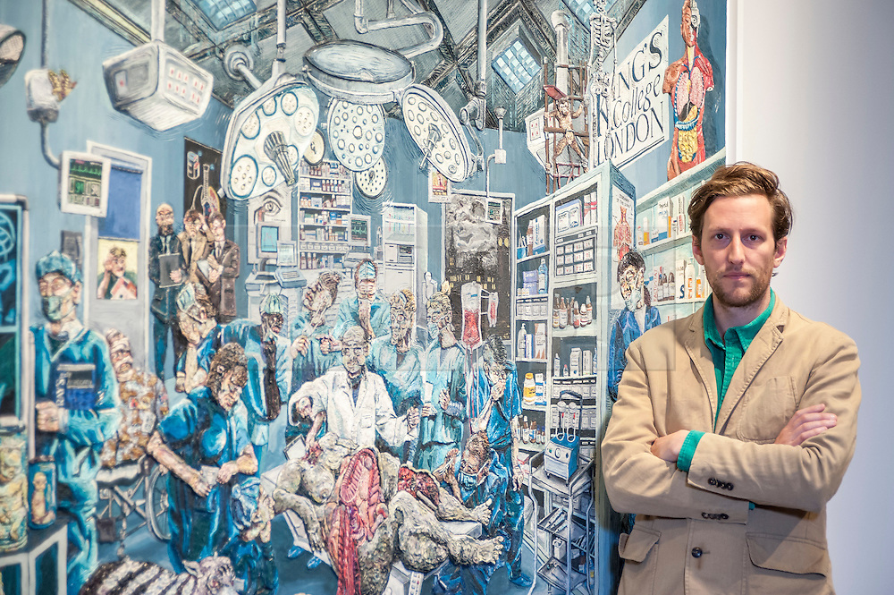 """© Licensed to London News Pictures. 22/04/2015. New Bond Street, London. London-based artist Henry Hudson, stands in front of the unveiling of """"The Autopsy at King's College"""", one in the series of works, using Plasticine as a medium, entitled """"The Rise and Fall of Young Sen - The Contemporary Artist's Progress"""" at Sotheby's.  The series follows the plight of Young Sen, from his home in rural China, to his rise on the international art scene and his eventual demise embroiled in a world of drugs, vice and the darkest corners of global politics. Photo credit : Stephen Chung/LNP"""