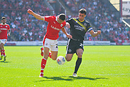 Jordan Williams of Barnsley (22) and Oliver Norburn of Shrewsbury Town (29) in action during the EFL Sky Bet League 1 match between Barnsley and Shrewsbury Town at Oakwell, Barnsley, England on 19 April 2019.