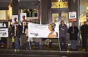 Demonstrators outside the De Beers launch of flagship store and new jewelry range.  New bond St. and afterwards at the In and Out Club. 21 November 2002. © Copyright Photograph by Dafydd Jones 66 Stockwell Park Rd. London SW9 0DA Tel 020 7733 0108 www.dafjones.com