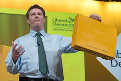 "© Licensed to London News Pictures. 14/03/2015. Liverpool, UK. Chief Secretary to the Treasury and Liberal Democrat Danny Alexander holds up a yellow ministerial briefcase with the words ""Liberal Democrat Budget"" The Liberal Democrat Spring Conference in Liverpool 14th March 2015. Photo credit : Stephen Simpson/LNP"