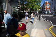Street scene on the Kings Road in Chelsea. In a selected few boroughs of West London, wealth has changed over the last couple of decades. Traditionally wealthy parts of town, have developed into new affluent playgrounds of the super rich. With influxes of foreign money in particular from the Middle-East. The UK capital is home to more multimillionaires than any other city in the world according to recent figures. Boasting a staggering 4,224 'ultra-high net worth' residents - people with a net worth of more than $30million, or £19.2million.. London, England, UK.