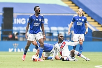 LEICESTER, ENGLAND - JULY 04: Wilfred Ndidi of Leicester City is frustrated with the referees decision after he challenges Christian Benteke of Crystal Palace during the Premier League match between Leicester City and Crystal Palace at The King Power Stadium on July 4, 2020 in Leicester, United Kingdom. Football Stadiums around Europe remain empty due to the Coronavirus Pandemic as Government social distancing laws prohibit fans inside venues resulting in all fixtures being played behind closed doors. (Photo by MB Media)