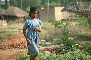 A young Indian girl is walking on the roads near the house of Budhia Singh,6, the famous Limca World Record marathoner, is training on the roads near his home in Salia Sahi slum (pop. 30.000) of Bhubaneswar, the capital of Orissa State, on Sunday, May 18. On May 1, 2006, Budhia completed a record breaking 65 km run from Jagannath temple, Puri to Bhubaneswar. He was accompanied by his coach Biranchi Das and by the Central Reserve Police Force (CRPF). On 8th May 2006, a Government statement had ordered that he stopped running. The announcement came after doctors found the boy had high blood pressure and cardiological stress. As of 13th August 2007 Budhia's coach Biranchi Das was arrested by Indian police on suspicion of torture. Singh has accused his coach of beating him and withholding food. Das says Singh's family are making up charges as a result of a few petty rows. On April 13, Biranchi Das was shot dead in Bhubaneswar, in what is believed to be an event unconnected with Budhia, although the police is investigating the case and has made an arrest, a local goon named Raja Archary, which is now in police custody. **Italy and China Out**