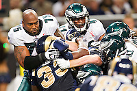 ST. LOUIS, MO - SEPTEMBER 11:   Juqua Parker #75 of the Philadelphia Eagles tackles Carnell Williams #33 of the St. Louis Rams at the Edward Jones Dome on September 11, 2011 in St. Louis, Missouri.  The Eagles defeated the Rams 31 to 13.  (Photo by Wesley Hitt/Getty Images) *** Local Caption *** Juqua Parker; Carnell Williams Sports photography by Wesley Hitt photography with images from the NFL, NCAA and Arkansas Razorbacks.  Hitt photography in based in Fayetteville, Arkansas where he shoots Commercial Photography, Editorial Photography, Advertising Photography, Stock Photography and People Photography