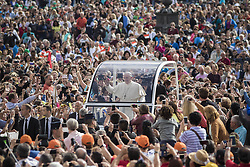 September 21, 2016 - Vatican City, Vatican - Pope Francis rides on the Popemobile through the crowd of the faithful as he arrives to celebrate his Weekly General Audience in St. Peter's Square in Vatican City, Vatican. (Credit Image: © Giuseppe Ciccia/Pacific Press via ZUMA Wire)