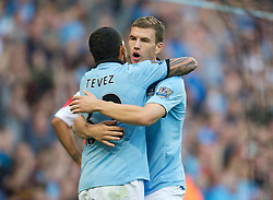 01.09.2012, Etihad Stadion, Manchester, ENG, Premier League, Manchester City vs Queens Park Rangers, 2. Runde, im Bild Manchester City's Edin Dzeko celebrates scoring the second goal against Queens Park Rangers with Carlos Tevez during the English Premier League 2nd round match between Manchester City and Queens Park Rangers at the Etihad Stadium, Manchester, Great Britain on 2012/09/01. EXPA Pictures © 2012, PhotoCredit: EXPA/ Propagandaphoto/ David Rawcliff..***** ATTENTION - OUT OF ENG, GBR, UK *****