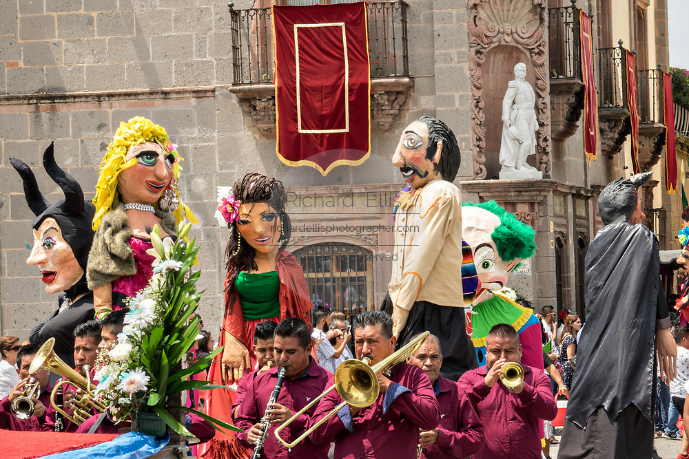 A brass band leads a procession of giant papier mâché puppets called mojigangas in the Jardin Allende during a children's parade celebrating Mexican Independence Day celebrations September 17, 2017 in San Miguel de Allende, Mexico.