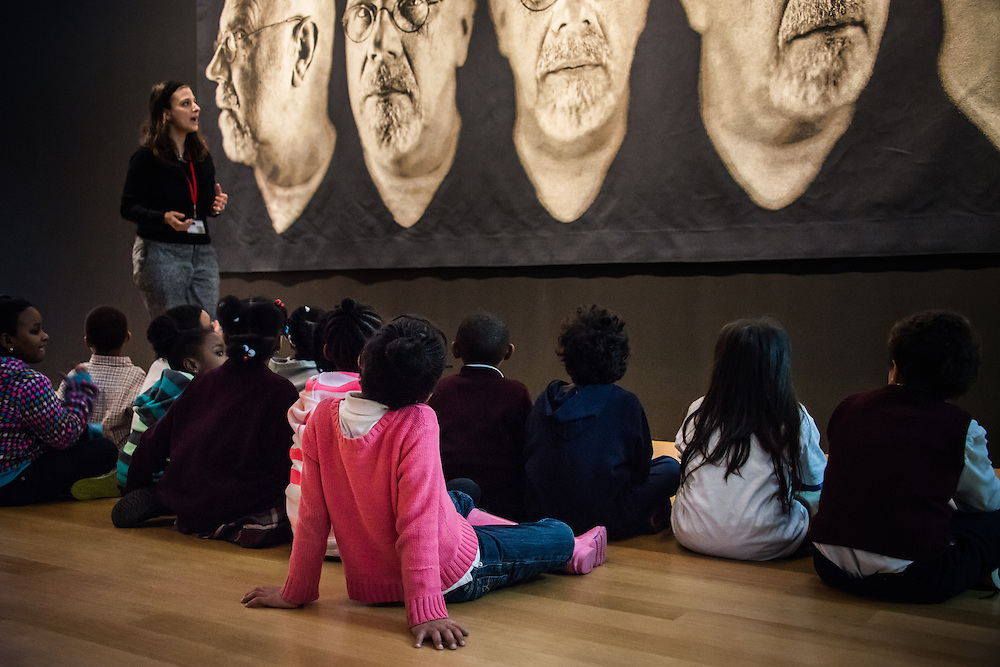 Youth Educatn Group in front of a Chuck Close Peice