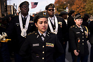 11 NOV. 2017 -- ST. LOUIS -- Cadet Lt. Col. Leilani Martinez joins other members of the US Army Jr. ROTC program from McCluer High School at parade rest before the start of the 34th annual St. Louis Regional Veterans Day Observance at Market and Tucker in downtown St. Louis Saturday, Nov. 11, 2017. Photo © copyright 2017 Sid Hastings.