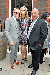 Left to right, TOMMY HILFIGER, his wife DEE and SIR PHILIP GREEN at the launch of the new collection from Limoland held at Anderson & Sheppard's Haberdashery, 17 Clifford Street,London on 16th June 2014.