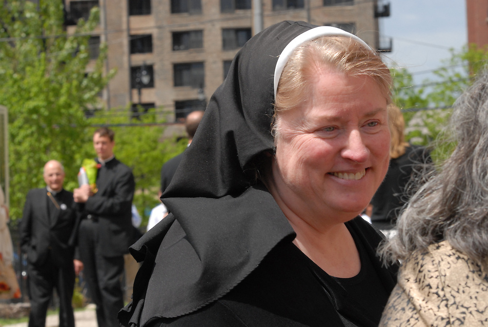 Sister Mary Paul McCaughy, Superintendent of Catholic School, chats with attendees of a ground breaking ceremony for an expanding Old St. Mary's Catholic School in Chicago's South Loop neighborhood.
