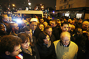 """The Mayor of Paris Anne Hidalgo with Hassan Chalghoumi, Iman and other official delegates meet with press and public and Porte Vincennes<br /><br />French and Jews come together to make a vigil outside a Kosher supermarket in Porte Vincennes, Paris, France. Yesterday this Kosher supermarket was the scene of a hostage taking and followed by an armed shoot out between Jihadist gunmen and French police. It ended in a shoot out and with the death of the terrorists. Some hostages were killed and police injured.<br /><br />This event was directly linked to the attack on the offices of Charlie Hebdo, killing twelve people, including the editor and celebrated cartoonists two days before. This week was the deadliest week of terror attacks in France for over fifty years. Charlie Hebdo is a satirical publication well known for its political cartoons. <br /><br />As a solidarity actions with the deaths at Charlie Hebdo many placards read """"Je suis Charlie"""" translating as """"I am Charlie (Hebdo)"""". Demonstrators held aloft pens, brushes and crayons, symbolizing the profession of journalists and cartoonists who were killed."""