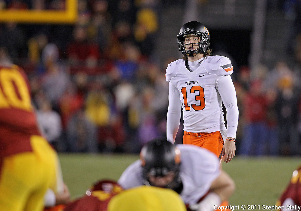November 18, 2011: Oklahoma State Cowboys kicker Quinn Sharp (13) lines up for a potential game winning field goal during the NCAA football game between the Oklahoma State Cowboys and the Iowa State Cyclones at Jack Trice Stadium in Ames, Iowa on Friday, November 18, 2011. Sharp missed the field goal. Iowa State upset Oklahoma State 37-31 double overtime.