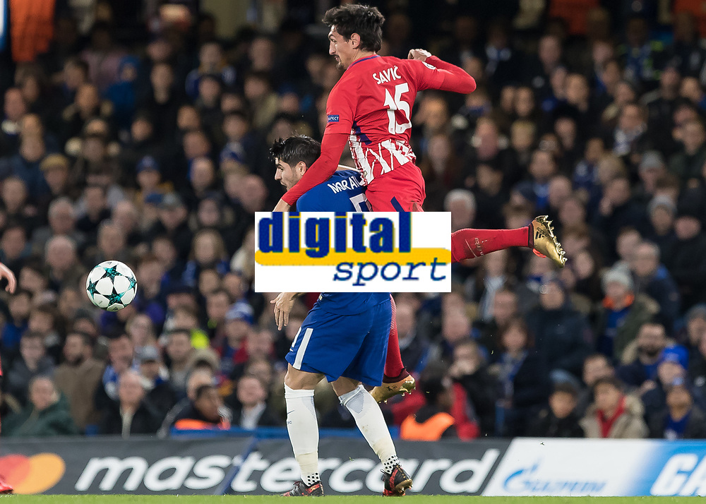Football - 2017 / 2018 UEFA Champions League - Group C: Chelsea vs. Atletico Madrid<br /> <br /> Alvaro Morata (Chelsea FC)  suffers a night of fouling as Stefan Savic (Atletico Madrid) climbs over and above him at Stamford Bridge.<br /> <br /> COLORSPORT/DANIEL BEARHAM