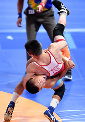 JAKARTA, Aug. 19, 2018  Bekhbayar Erdenebat (Bottom) of Mongolia vies with Kang Kum Song of the Democratic People's Republic of Korea during Men's Wrestling Freestyle 57 kg Final of the 18th Asian Games in Jakarta, Indonesia, Aug. 19, 2018. Erdenebat won 8-2. (Credit Image: © Yue Yuewei/Xinhua via ZUMA Wire)