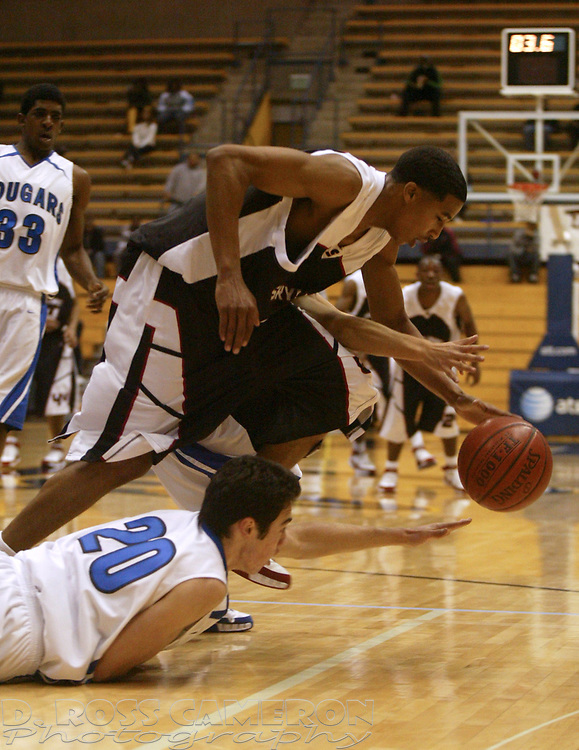 Skyline's Kwame' Vaughn grabs a loose ball ahead of Newark Memorial's Evan Kobori (20) in the closing seconds of the second quarter during their Martin Luther King Holiday Classic boys' high school basketball game, Monday, Jan. 21, 2008 at Haas Pavilion in Berkeley, Calif. Skyline won 58-56. (D. Ross Cameron/The Oakland Tribune)
