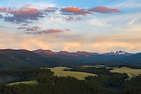 Colorful clouds hang above the 13,005 feet high Black Tooth Mountain on a July evening.