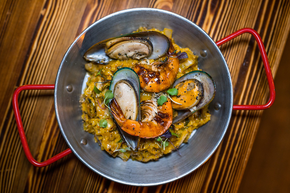 """NEW YORK, NY - NOV 5, 2016: """"Kimchi Paella"""" -  Caramelized kimchi, blue mussels, white tiger shrimps and parmesan - served at Thursday Kitchen in Manhattan. CREDIT: Emon Hassan for The New York Times"""