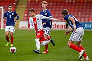 Nicola Zalewski wins the ball during the U17 European Championships match between Scotland and Poland at Firhill Stadium, Maryhill, Scotland on 26 March 2019.
