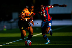 Adama Traore of Wolverhampton Wanderers takes on Tyrick Mitchell of Crystal Palace - Mandatory by-line: Robbie Stephenson/JMP - 20/07/2020 - FOOTBALL - Molineux - Wolverhampton, England - Wolverhampton Wanderers v Crystal Palace - Premier League