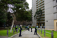A large police presence is seen at all affected towers amid a full and total lockdown of 9 housing commission high rise towers in North Melbourne and Flemington during COVID-19 on 5 July, 2020 in Melbourne, Australia. After 108 new cases where uncovered overnight, the Premier Daniel Andrews announced on July 4 that effective at midnight last night, two more suburbs have been added to the suburb by suburb lockdown being Flemington and North Melbourne. Further to that, nine high rise public housing buildings in these suburbs have been placed under hard lockdown for a minimum of five days, effective immediately.  Residents in these towers will not be allowed to leave their units for any reason. Police will be stationed at every entry and exit point, every level, and they will also surround these locations preventing any movement in, or out. There is a total of 1354 units and over 3000 residents living in these buildings including the states most vulnerable people. These new restrictions will remain in place for fourteen days with fears of further lockdowns to come. The Government have stressed that if Victorians do not follow the basic COVIDSafe rules, the whole state will go back in to lockdown. (Image by Dave Hewison/ Speed Media)