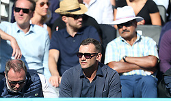 Andriy Shevchenko (centre) during day four of the Fever-Tree Championship at the Queen's Club, London.