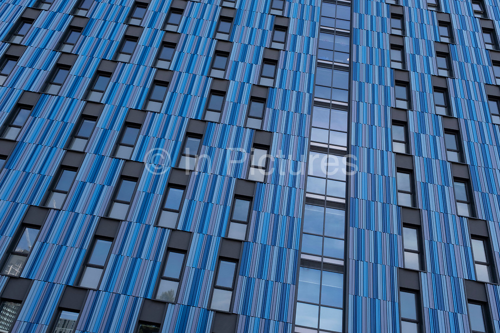 Blue architectural detail and pattern on the exterior of the Altura student accommodation building in Five Ways on 31st March 2021 in Birmingham, United Kingdom. Modern student living in cities like Birmingham is now often in purpose built blocks such as this rather than in individual homes.