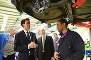 © Licensed to London News Pictures. 14/02/2013. Bedford, UK. Ed Miliband talks to an apprentice. Ed Miliband MP, Leader of the Labour Party, delivers a major speech at Bedford Training Group in Bedford today, 14th February 2013. In the speech he set out a 'One Nation Labour agenda for rebuilding Britain's economy'. The speech was followed by a Q&A session with Ed Balls, Shadow Chancellor and a tour of the training facility. Photo credit : Stephen Simpson/LNP