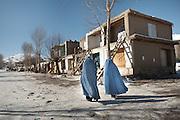 Women in Burqa in the border town of Ishkashim, on the Tajikistan - Afghanistan border. Hindukush mountains.