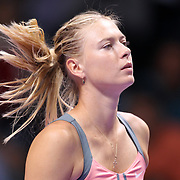 Russia's Maria Sharapova hits a return to Serena Williams of the U.S. during their final WTA tennis championships match in Istanbul, October 28, 2012. Photo by TURKPIX