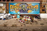"15 AUGUST 2020 - MINNEAPOLIS, MINNESOTA: The George Floyd Memorial in Minneapolis. Floyd, an unarmed Black man, was killed by Minneapolis police officers of May 25 in front of Cup Foods, a convenience store at the intersection of 38th and Chicago Ave. His killing sparked a week of violent protests across the country. The intersection where he was killed is still closed and has become an unofficial memorial visited by hundreds of people every day. Saturday, more than 100 people gathered at the memorial to demand the city preserve the memorial. The city of Minneapolis had planned to start reopening the intersection as soon as Monday Aug. 17, but delayed those plans indefinitely on Friday, Aug. 14. City residents have created a ""George Floyd Zone"" at the intersection. They're demanding the recall of Hennepin County Attorney Mike Freeman, requiring Minneapolis police officers have their own private liability insurance, and the allocation of funds for businesses and residents in the community. The city is considering officially renaming Chicago Ave. between 37th and 39th ""George Floyd Jr. Place.""     PHOTO BY JACK KURTZ"