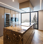 Modern marble kitchen with island. Nobody inside