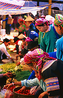 Traditionaly dressed ethic minority women shopping at a local market in Northern Vietnam.