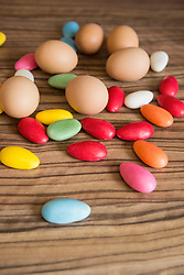 Close-up of Easter eggs with colourful candies