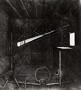 Projecting the sun's image through a refracting telescope onto a screen in a darkened room (camera obscura) in order to study sunpots.  From 'Selenographia' by Johannes Hevelius (Gedani, Gdansk. Danzig,  1647).   Engraving.