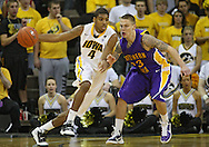 December 07 2010: Iowa Hawkeyes guard/forward Roy Devyn Marble (4) tries to drive around Northern Iowa Panthers guard Marc Sonnen (23) during the first half of their NCAA basketball game at Carver-Hawkeye Arena in Iowa City, Iowa on December 7, 2010. Iowa defeated Northern Iowa 51-39.