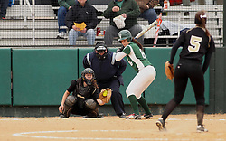 30 March 2013:  Kaity Crane batting during an NCAA Division III women's softball game between the DePauw Tigers and the Illinois Wesleyan Titans in Bloomington IL
