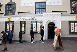 As England eases out of Coronavirus lockdown no 3, hospitality reopens for alfresco dining on 12 April 2021. Queuing to get into McDonalds, Norwich UK
