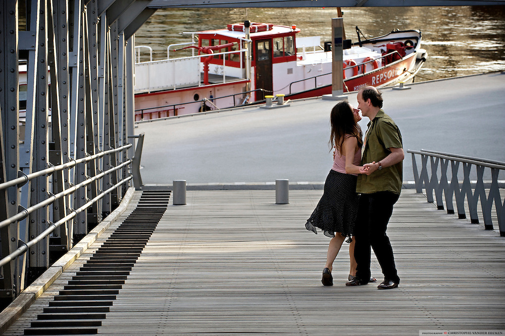 Hamburg, Germany, Jun 06, 2010, Couple dancing tango along the River Elbe.