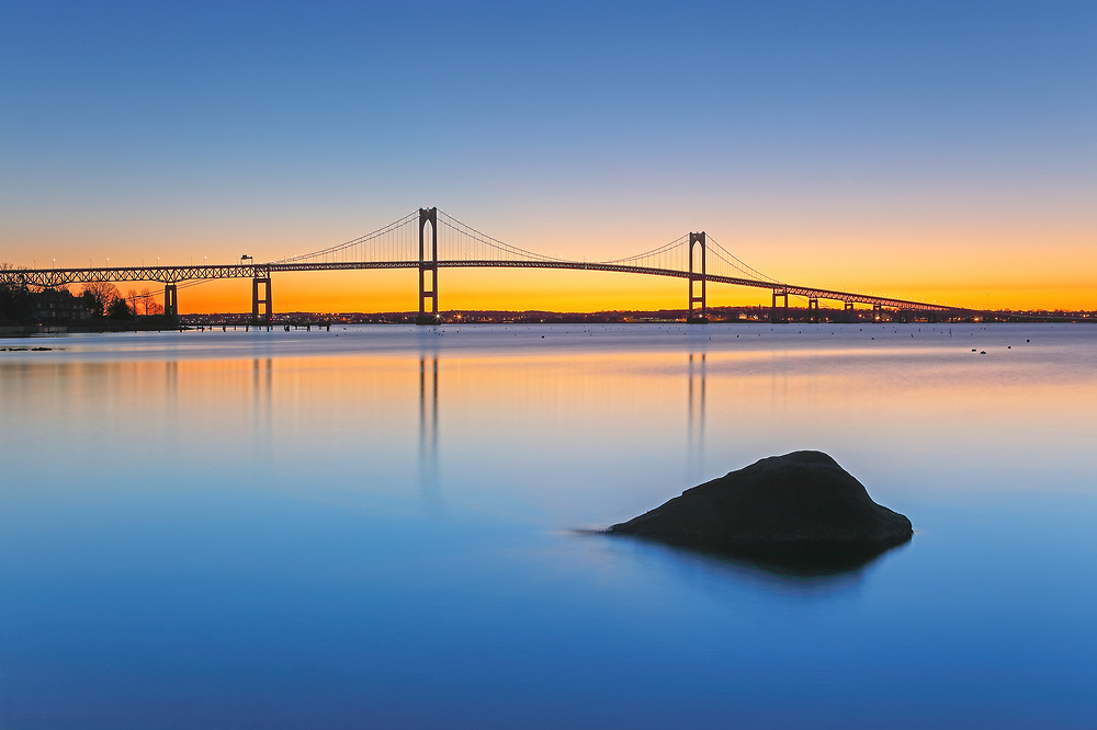 Rhode Island sunrise photographs of the Claiborne Pell Bridge are available for image licensing and as museum quality photography prints, canvas prints, acrylic prints, wood prints or metal prints. Wall art prints may be framed and matted to the individual liking and room decor needs:<br /> <br /> http://juergen-roth.pixels.com/featured/the-claiborne-pell-bridge-juergen-roth.html<br /> <br /> Coastal Rhode Island seascape sunrise photography showing the Claiborne Pell Bridge that spans Narragansett Bay connecting the City of Newport on Aquidneck Island and the Town of Jamestown on Conanicut Island. Rhode Island has become an inspiration and is a heaven for macro, seascape, and landscape photography that makes for great wall art. Especially sunrise, sunset and the light of the golden hours paint the sky in beautiful colors and bring out the beauty of the Ocean State.<br /> <br /> Good light and happy photo making! <br /> <br /> My best, <br /> <br /> Juergen <br /> Image Licensing: http://www.RothGalleries.com <br /> Fine Art Prints: http://fineartamerica.com/profiles/juergen-roth.html <br /> Photo Blog: http://whereintheworldisjuergen.blogspot.com <br /> Twitter: https://twitter.com/naturefineart <br /> Facebook: https://www.facebook.com/naturefineart <br /> Instagram: https://www.instagram.com/rothgalleries