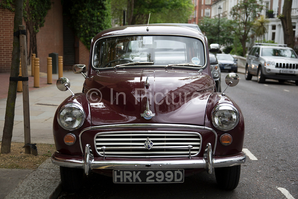 A vintage Morris Minor Traveller car in London, UK. The Morris Minor is a British economy car that debuted on 20September 1948. Designed under the leadership of Alec Issigonis, more than 1.3million were manufactured between 1948 and 1972. Initially available as a two-door saloon, the range was subsequently expanded to include a wood-framed estate (the Traveller) from 1952.